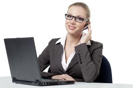 phone operator: Portrait of female phone operator against white background