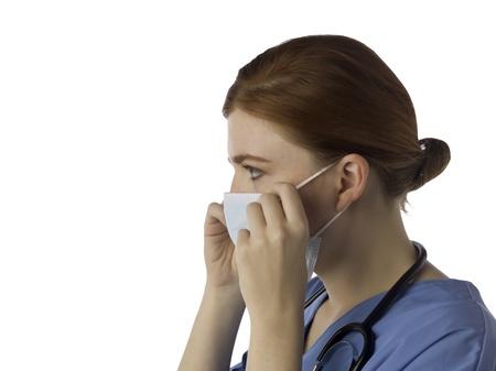 medical mask: Imagen Vista lateral del doctor de sexo femenino con una m�scara m�dica aislada en un fondo blanco Foto de archivo