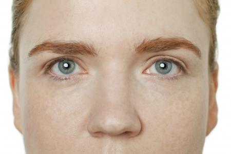 gray eyes: Blue gray eyes of a caucasian woman Stock Photo