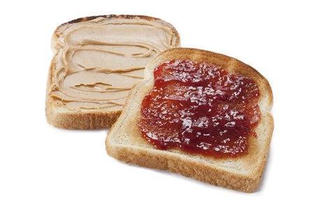 Bread toast with peanut butter and jam displayed on white background. Stock Photo - 17134732