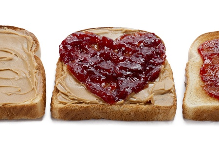 Close-up shot of bread toast with peanut butter spread and jam. photo