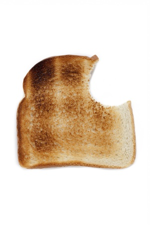 missing bite: Close-up of a toast with missing bite displayed on white background.