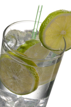 Glass of cold drink with lime and straw at the side Stock Photo - 17134733