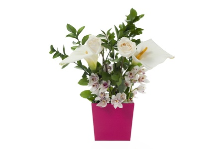 Image of different kind of flowers in pink vase against white background photo