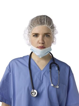 medical mask: Retrato de una doctora en uniforme m�dico con estetoscopio, m�dico m�scara y redecilla Foto de archivo