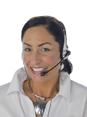 Portrait of happy female phone operator against white background photo