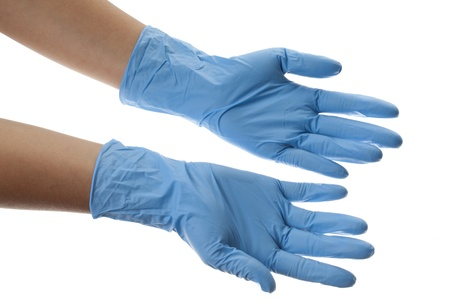 protective: Close-up image of hguman hands wearing blue surgical gloves. Stock Photo
