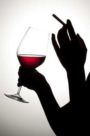 Human drinking and smoking in a silhouette image Stock Photo - 17134638