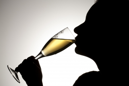 Silhouette shot of a person drinking champagne. Stock Photo - 17134596