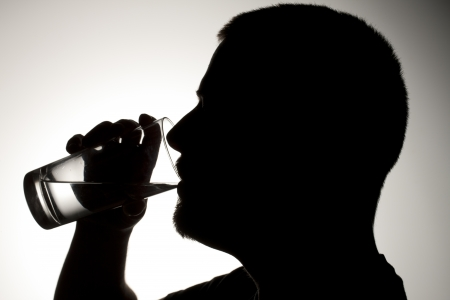 Silhouette image of the man drinking water Stock Photo - 17134600