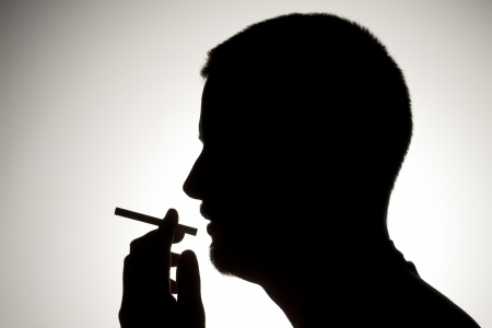 Silhouette man smoking cigarette Stock Photo - 17134636