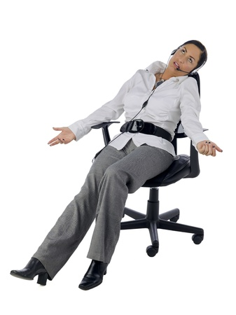 phone operator: Portrait of stressed female phone operator against white background Stock Photo