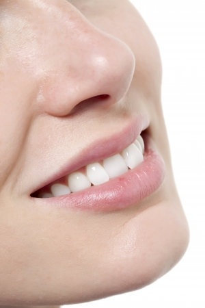 Close up image of woman lips with toothy smile