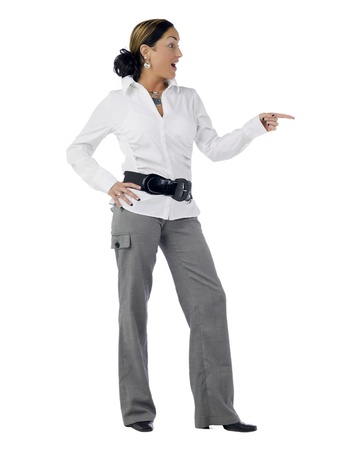Full length portrait of Woman wearing casual attire pointing something photo