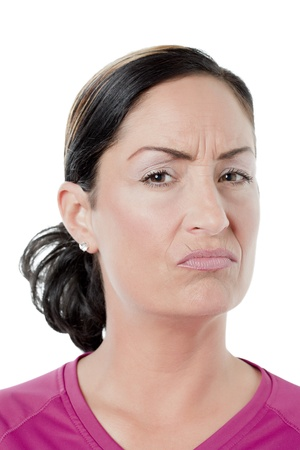 Portrait of woman with annoyed expression against white background photo
