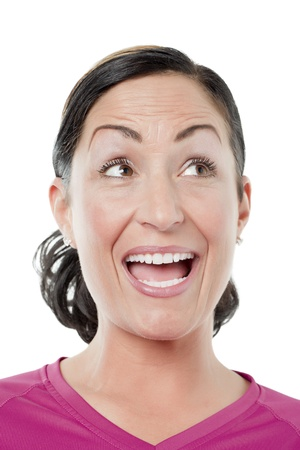 Close-up image of a woman with a funny face looking up on a white surface photo