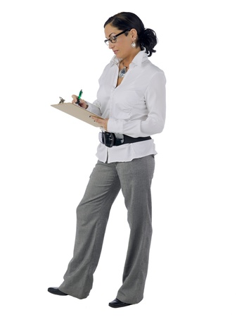 Mid-adult businesswoman writing on a clipboard photo