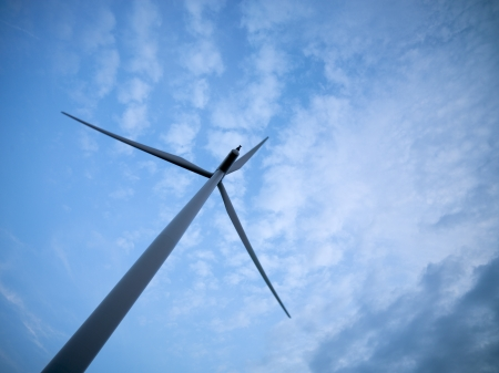 Low angle view of a wind turbine against cloudy sky in the background. Stock Photo - 17135226