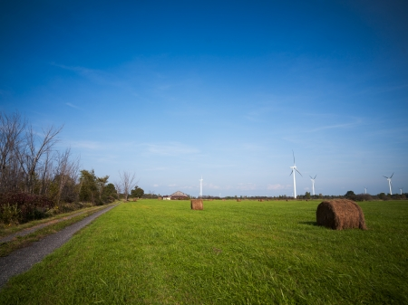 View of hay bale with wind turbine in the background. Stock Photo - 17135280