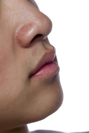Close up image of male lips against a white background