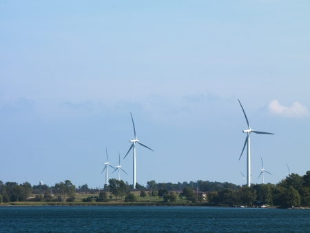 Image if a wind farm with river in the foreground. Stock Photo - 17135214