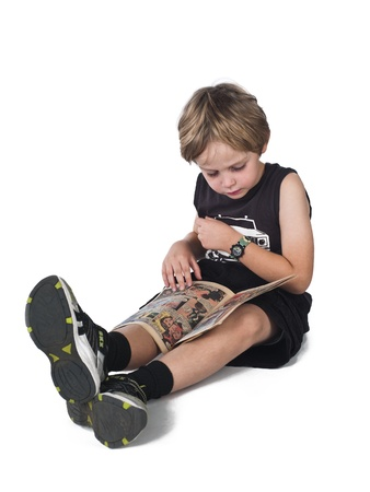 Blonde boy reading comic book over white background, Imagens