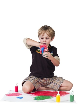 Boy doing painting over white background. Stock Photo - 17135063