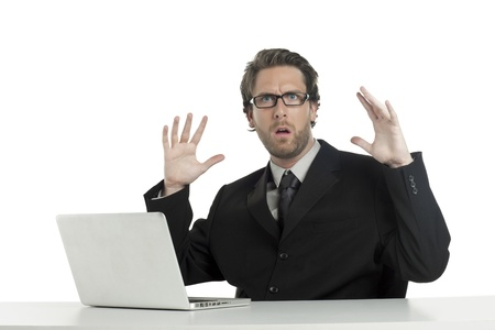 Close-up image of shocked businessman with a surrender gesture on a white background Stock Photo - 17135086