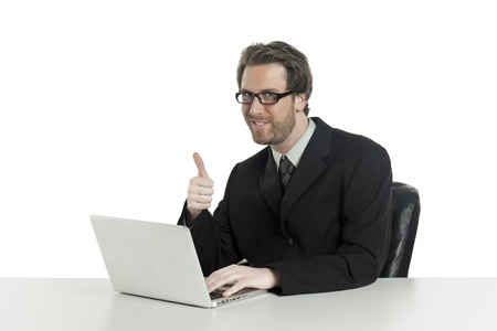 Businessman doing a thumbs up while using his laptop Stock Photo - 17135071