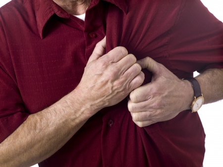 heart disease: Close up image of old man having chess pain against white background Stock Photo