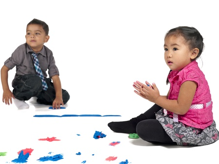 Curious little kids playing with color and clay over white background Stock Photo - 17135140