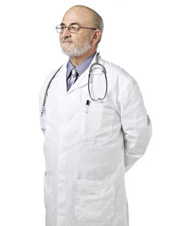 Portrait of an old doctor thinking deeply with hands on his back over a white background