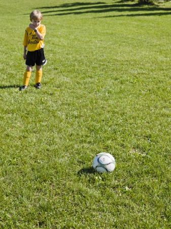 level playing field: Little soccer player ready to kick the ball.