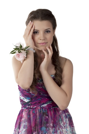 prom queen: Portrait of a fashionable woman with corsage isolated over the white background