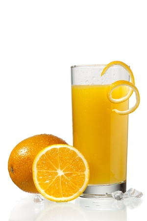 View of a glass of orange juice with orange skin peeling on top, orange slice on white surface. Stock Photo - 17135082