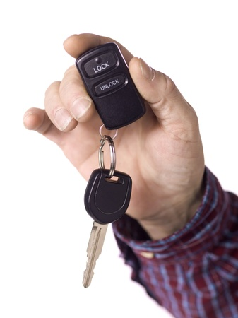Close up image of human hand holding car key against white background Stock Photo - 17135066