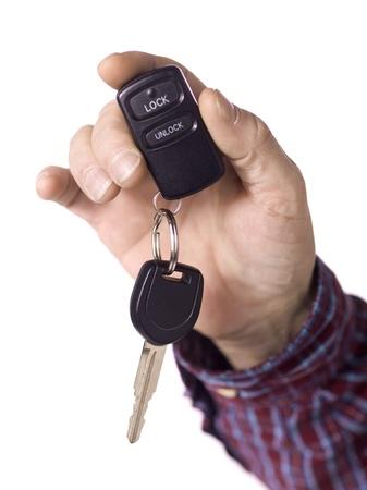 Close up image of human hand holding car key against white background Stock Photo - 17135066