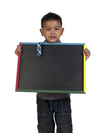 slateboard: Little Asian boy holding slateboard against white background,