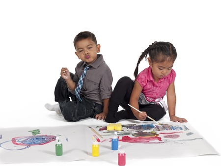 Little Asian kids painting over white background,  and Kai Wall Stock Photo - 17135143