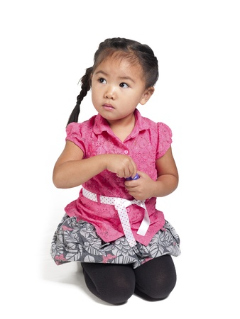 about age: Little girl holding bubble wand over white background,