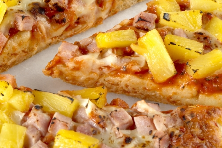 A macro image of hawaiian pizza photo