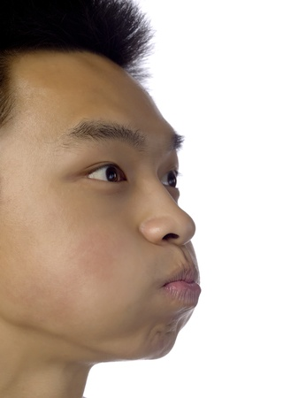 puffed cheeks: Closed up shot of a man trying to hold his breath