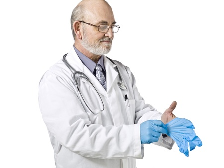 Horizontal image of a medical doctor putting on his medical gloves over a white background photo