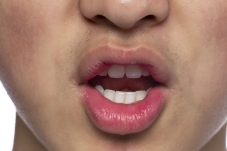 Close up image of open mouth of a guy