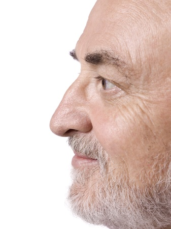 Side view shot of an old man's face isolated in a white background