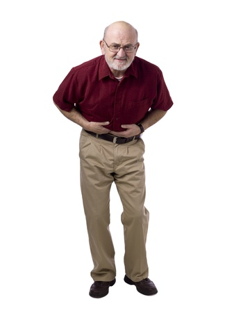 Portrait of old man having stomach pain against white background photo
