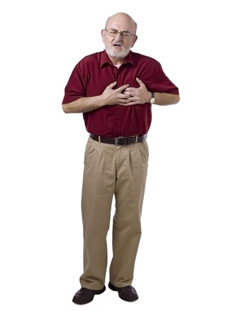 Portrait of old man suffering heart ache against white background photo