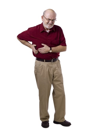 seniors suffering painful illness: Image of old man suffering stomach ache against white background