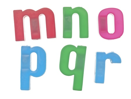 r p m: Close-up image of a plastic alphabet letters mnopqr on a white background Stock Photo