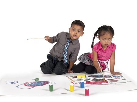 Playful little Asian kids painting over white background,  and Kai Wall Stock Photo - 17135342